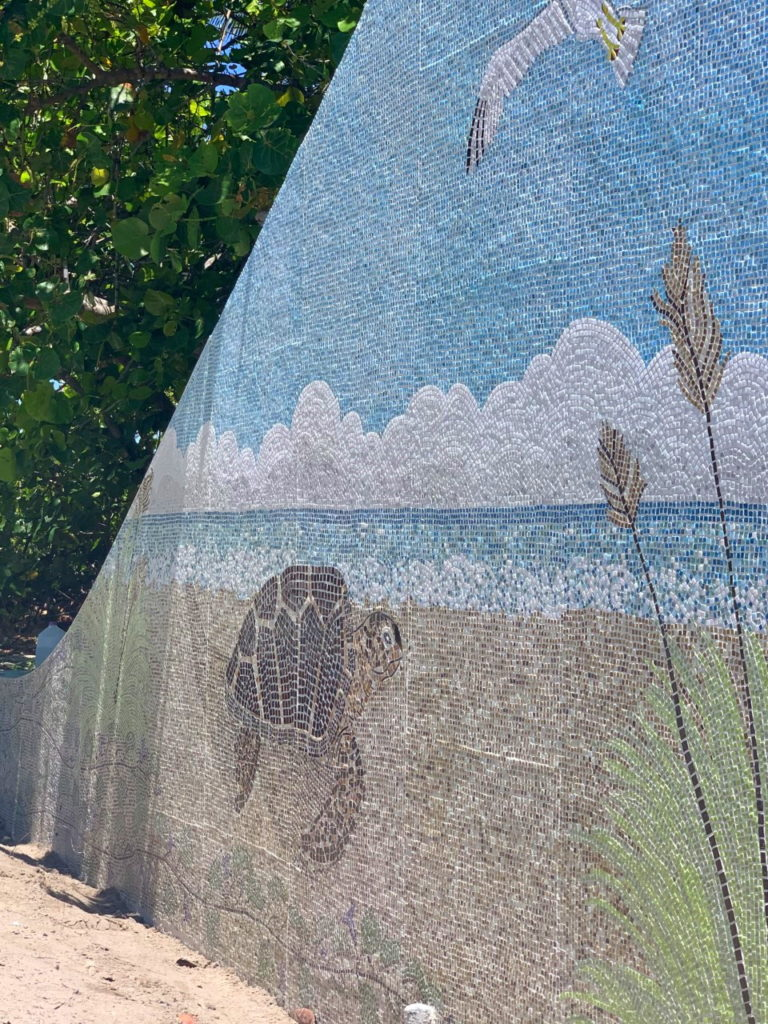 Decorative mosaic of turtles, beach and seagulls.